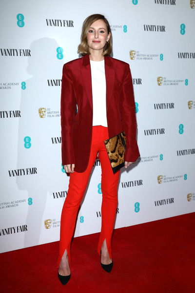 Laura Carmichael tied her look together with a printed clutch.