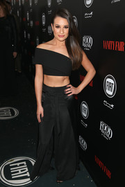 Lea Michele matched her top with a pair of black wide-leg pants by Vatanika.