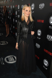 Molly Sims played down the sexiness with a black leather jacket.
