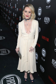 Taryn Manning put on a daring display in a plunging cream button-front dress at the Vanity Fair and Fiat Young Hollywood celebration.