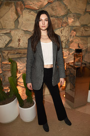 Jacquelyn Jablonski sealed off her look with a pair of flared pants.
