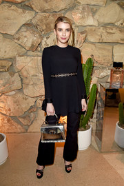 Emma Roberts injected a bright spot with a silver Proenza Schouler purse.