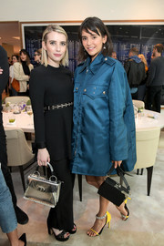 Nina Dobrev attended the launch of Proenza Schouler's Arizona fragrance carrying a stylish black box purse.