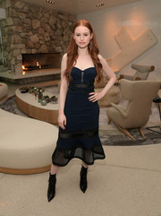Madelaine Petsch looked sultry in a navy mesh-panel corset dress at the launch of Proenza Schouler's Arizona fragrance.