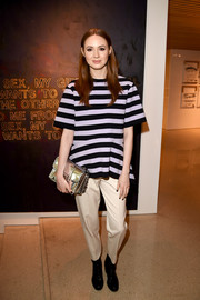 Karen Gillan kept the rest of her look casual with a pair of cream-colored slacks.