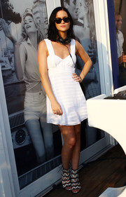 Leigh Lezark looked airy in a little white dress with side cutouts during the Vanity Fair and Guess Summer Soiree.