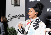 Janelle Monae accessorized with a black-and-white square-patterned clutch during Vanity Fair's celebration of 'Hidden Figures.'