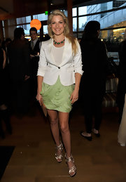 Ali looked summer-chic in a white blazer and a draped green mini skirt.