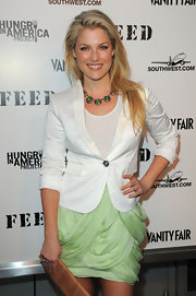 Actress Ali Larter was ready for spring in her green skirt and white blazer. She added a some additional green flare with a gemstone necklace.