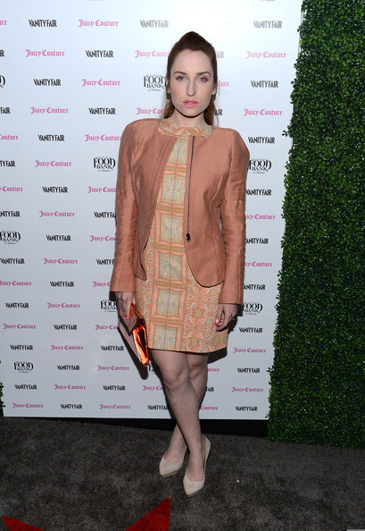 Zoe Lister Jones' fitted peach jacket added to her peach and pink look at the 2013 Vanities Calendar celebration.