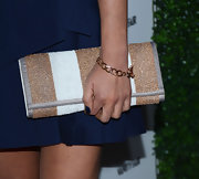 Olivia Munn's oversized straw clutch gave the actress a classic vibe at the 2013 Vanities Calendar event.