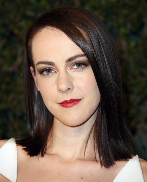 Jena Malone's red lipstick looked striking against her white skin.
