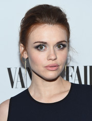 Holland Roden wore her hair in a mildly messy, teased updo at the Toast to Young Hollywood event.
