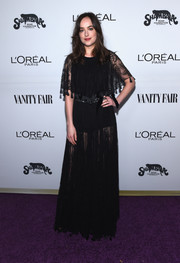 Dakota Johnson was boho-sexy in a sheer black Dior gown with a layered bodice during the Toast to Young Hollywood event.