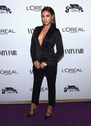 Shay Mitchell styled her outfit with black diagonal-strap pumps by Olgana Paris.