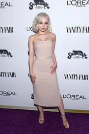 Dove Cameron sheathed her slim figure in a strapless nude dress by Elizabeth and James for the Toast to Young Hollywood event.