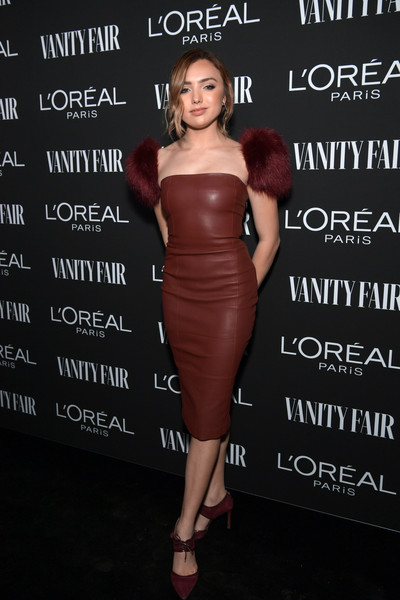 Peyton List matched her dress with a pair of maroon suede pumps.