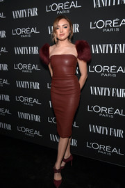 Peyton List donned a flirty-meets-edgy fur-sleeve leather dress by Area at the Vanity Fair New Hollywood celebration.