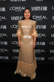 Yalitza Aparicio got glam in a gold The Vampire's Wife gown with a ruffled hem and sleeves for the Vanity Fair New Hollywood celebration.