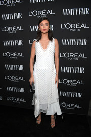 Nina Dobrev charmed in a beaded white dress by Loewe at the Vanity Fair New Hollywood celebration.