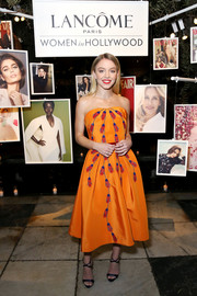 Sydney Sweeney cut a vibrant figure in a strapless orange cocktail dress at the Vanity Fair and Lancome Women in Hollywood event.