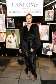Catt Sadler looked flamboyant in a shimmering black Attico jumpsuit with feathered sleeves at the Vanity Fair and Lancome Women in Hollywood event.