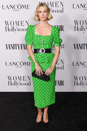 January Jones paired her frock with a black frame clutch.