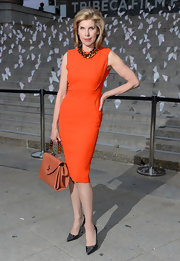 Chritine Baranski stunned in a classic sheath dress in a cool and contemporary orange.