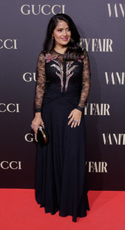 Salma Hayek chose a black Gucci gown with a flower-embellished lace bodice for the Vanity Fair Personality of the Year Gala.