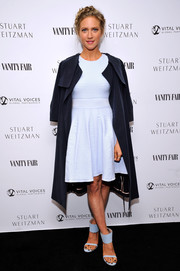 Brittany Snow topped off her dress with a navy duster coat, also by Ted Baker London.