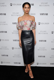 Lily Aldridge went for an edgy-sexy finish with a black leather pencil skirt, also by Brock Collection.