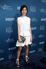 Gemma Chan chose a sleeveless white peplum dress by Louis Vuitton for the Newport Beach Film Festival Fall Honors.