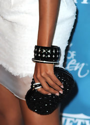 Kerry finished off her white strapless dress with a chunky bracelet.