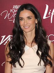 Demi Moore wore her dark locks in long curls for the Power of Women Luncheon.