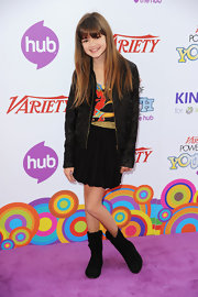 Ciara Bravo added a rugged touch to her colorful top and mini skirt with a leather jacket and a pair of mid-calf boots.