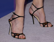 Nicole Kidman attended the Variety Power of Women event wearing ultra-sophisticated gold and black evening sandals by Jimmy Choo.