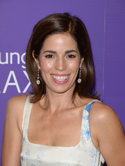 Ana Ortiz topped off her look with a fun flip when she attended the Variety Power of Women event.