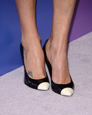 Charlize Theron kept the cap-toe trend alive with these black-and-white pumps at the Variety Power of Women event.
