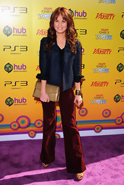 Debby Ryan looked ready to disco at the Power of Youth event in a pair of '70s style merlot corduroy flares.