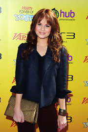 Debby Ryan wore a midnight blue blazer with rolled cuffs for the Power of Youth event.