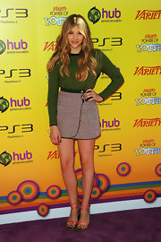 Chloe Moretz donned a green and black checkered sweater with a high-waisted tweed skirt for the Power of Youth Event.