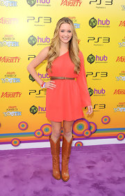 Greer Grammer opted for a funky red carpet look, wearing a one-sleeved coral frock paired with tan cowboy boots.