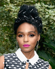 Janelle Monae swiped on some bright pink lipstick for an eye-popping beauty look.
