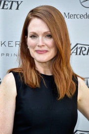Julianne Moore opted for a simple side-parted 'do when she attended the Creative Impact Awards.