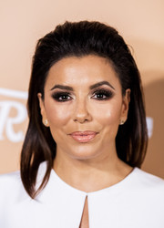 Eva Longoria finished off her beauty look with a glossy pout.