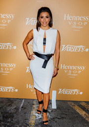 Eva Longoria heated up Variety's '10 Latinos to Watch' party in this white cut-out dress, which she paired with a wide leather belt.