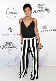 Emmanuelle Chriqui teamed her top with black-and-white striped pants.