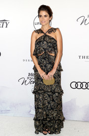 Nikki Reed paired her dress with a gold hard-case clutch.