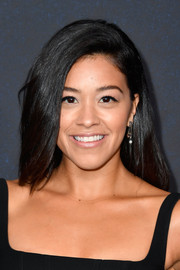Gina Rodriguez sported a simple yet elegant side-parted hairstyle at the Variety Power of Women Los Angeles event.