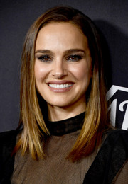 Natalie Portman looked elegant wearing her hair in soft layers at the Variety Power of Women Los Angeles event.
